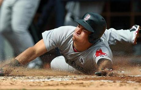 Jose Iglesias dove into home plate with one of four second-inning runs for the Red Sox.