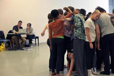 Boston Conservatory students warm up before rehearsal.