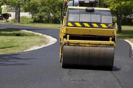 Old asphalt should be removed before repaving a driveway.