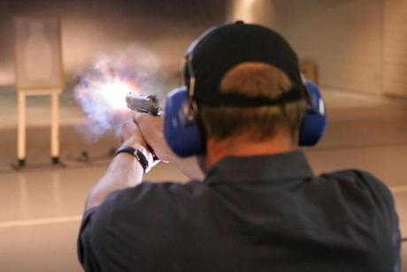 Diederik van Hoogstraten test-fires a Smith & Wesson Model 1911 in 45 ACP handgun at the Smith & Wesson Academy in Springfield, Massachusetts, Friday, August 18, 2006. Smith & Wesson Holding Corp., fresh from winning military contracts in Afghanistan, now wants a bigger prize back home: an Army deal worth as much as $500 million that would be its biggest defense order ever. Photographer: JB Reed/Bloomberg News. Library Tag 04292008 -- 0414guns
