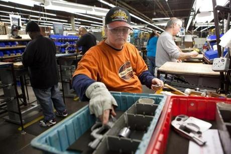 Smith & Wesson employee Peg Bowles assembles a pistol at the Smith & Wesson manufacturing plant in Springfield, Mass., on Tuesday, December 21, 2010. Smith & Wesson has received new state tax incentives, up to six million dollars worth, that will enable expansion of their Springfield plant including the hiring of many new workers. -- 0414guns