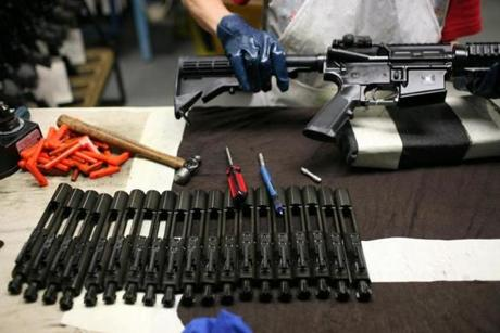 In its last stages of assembly, bolt mechanisms are installed before the weapon is tested in the firing range. The Colt Defense factory in Hartford, Conn., makes the m16 and M4 rifles, which are the main rifles of choice of the US military. Photo by Todd Heisler/The New York Times -- 0414guns