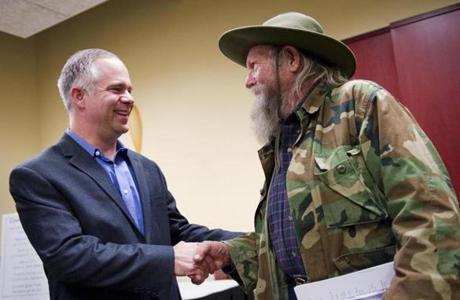Representative Tim Huelskamp, shown with a constituent, represents one of the country's most conservative congressional districts.
