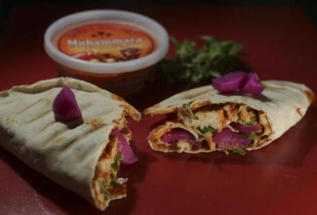 Chicken wrap with muhammara sauce.