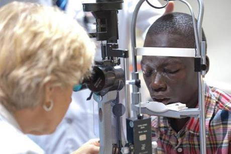 Surgeries have restored Deng's ability to see some colors in his right eye. His slave master blinded him when he was 6 as punishment.