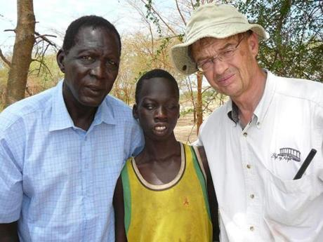 Keer Deng (center) was sold into slavery in his native Sudan when he was about 5. This picture is of him on the day he was liberated.
