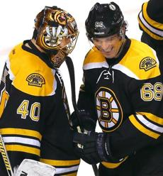 The Nos. 1 and 2 stars, Tuukka Rask and Jaromir Jagr, get together after the Bruins' victory.