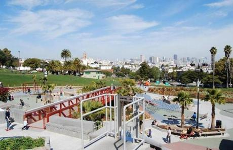 The view of downtown from the top of the slide at Dolores Park Playground.