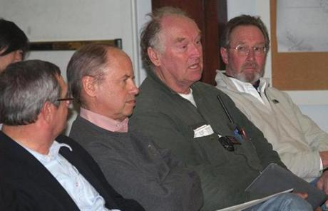 Richard Schifter (second from left) obtained permission from the Edgartown Conservation Commission to relocate his home.