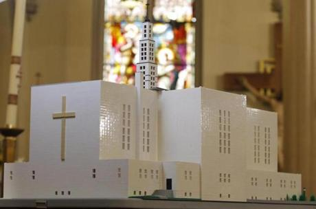 A replica of the closed St. Joseph Church made entirely from legos is seen at St. James Church.