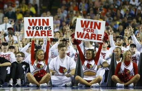 Cheerleaders held signs for injured guard Kevin Ware during the game.