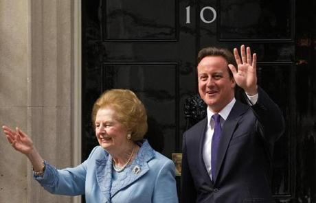 Thatcher waving to photographers as she stood with Prime Minister David Cameron in 2010.