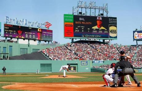 Clay Buchholz threw a pitch to Nate McLouth of the  Orioles in the first inning at the Fenway home opener.