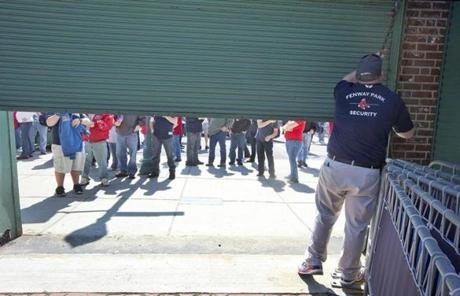 Fans waited to enter as the doors to Fenway opened on Monday afternoon.