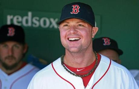 Jon Lester was all smiles in the dugout just before the start of player introductions.