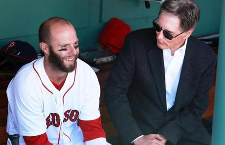Red Sox second baseman Dustin Pedroia chatted with owner John Henry in the dugout before the gam