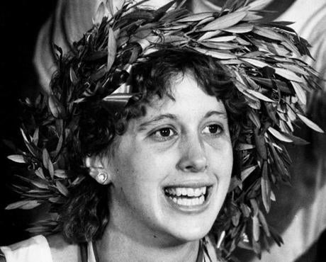 April 15, 1985:  Lisa Larsen Weidenbach happily wore the laurel wreath presented to marathon winners. The wreaths, fashioned from branches of olive trees in Marathon, Greece, were made specifically for the Boston Marathon winners each year. This was the last year before winners were offered prize money.