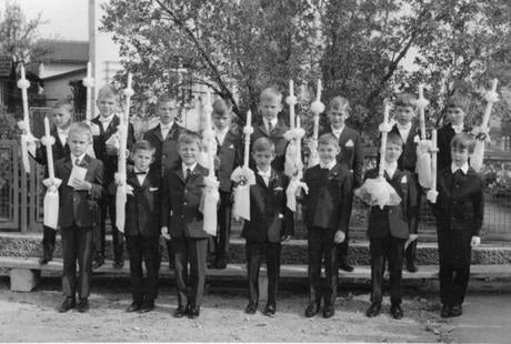 Christian Karl Gerhartsreiter (fourth from left in front row)presented a candle at his first holy communion as a youth in Bergen.