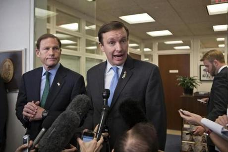 """It is not perfect, but it is important,"" Senator Chris Murphy (right) said of the package of gun proposals."