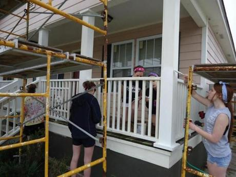 Mansfield High School students painting a home in Bay St. Louis, Mississippi.