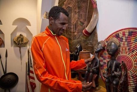 Marathoner Gebre Gebremariam admires the Ethiopian art work at the Addis Red Sea restaurant in the South End.