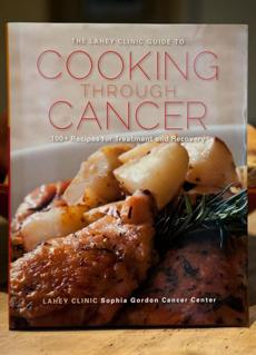 "A copy of the cookbook, ""The Lahey Clinic Guide to Cooking Through Cancer: 100+ Recipes for Treatment and Recovery."""