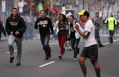 People ran away from explosions on Boylston Street, near the Boston Marathon finish line.