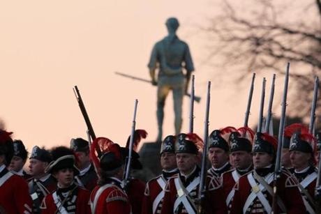 April 15, 2013-LEXINGTON--- PATRIOTS' DAY LEXINGTON, MA -- The British soldiers arrive on the Battle Green as the sun rises above the Minute Man statue, as the 238th anniversary of the Battle of Lexington begins Monday morning. (globe staff photo: Joanne Rathe The Boston Globe metro )