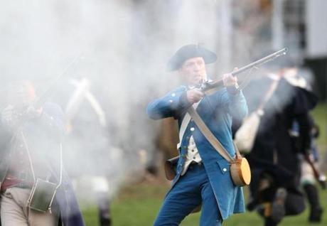 April 15, 2013-LEXINGTON--- PATRIOTS' DAY LEXINGTON, MA --Minute Men and the British fire on each other during the re-enactment of the Battle of Lexington early Monday morning, on the 238th anniversary of the first day of the American War for Independence. (globe staff photo: Joanne Rathe The Boston Globe metro )