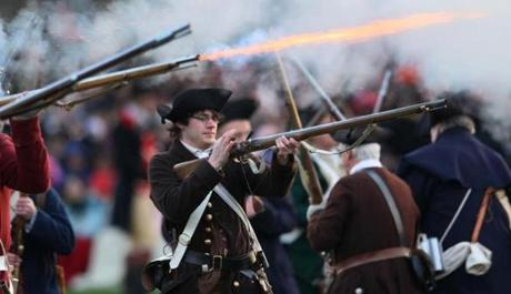 April 15, 2013-LEXINGTON--- PATRIOTS' DAY LEXINGTON, MA -- Minute Men load and shoot their muskets as they fight British soldiers on the Lexington Green during the 238th re-enactment of hte Battle of Lexington early Monday morning. (globe staff photo: Joanne Rathe The Boston Globe metro )