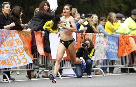 The leader for the elite women, Yolanda Caballero, ran by Wellesley College.