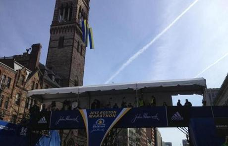 The Boston Marathon finish line at Boylston Street was still calm as runners began their route Monday morning.