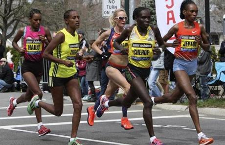 Rita Jeptoo, far right, was in a pack following Ana Dulce Felix (not shown) up Heartbreak Hill in Newton.
