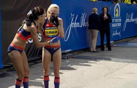 Marblehead  native Shalane Flannagan , right, and her training partner Kara Goucher after they crossed the finish line in fourth and sixth place respectively.