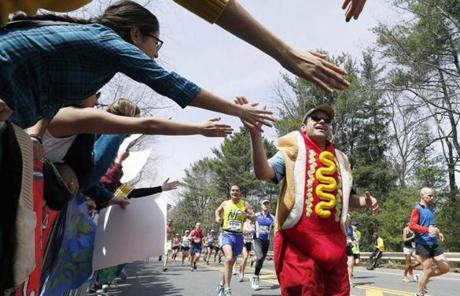 A man dressed as a hot dog high-fived the crowd in  Wellesley.