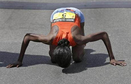 Women's winner Rita Jeptoo of Kenya kissed the pavement after she crossed the finish line.