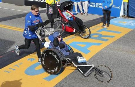 Dick Hoyt, left, and his son, Rick, at the start of the race.