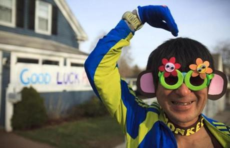 Yoshi Naruse of Rochester Hills, Mich., was about to run his third Boston Marathon dressed from head to toe as a monkey.