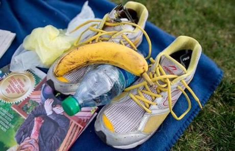 Martin's running shoes, a banana, and a bottle of water. He says he has run the marathon more than 10 times.
