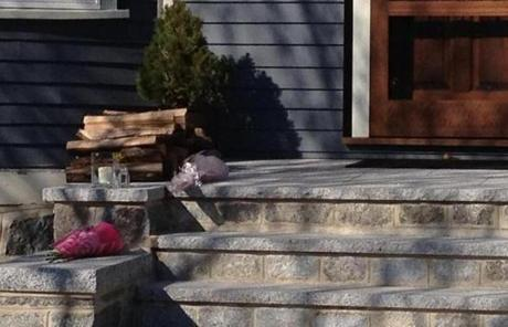 Neighbors have begun leaving flowers outside the Dorchester home of the eight-year-old killed during yesterday's attack.