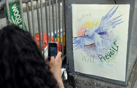 A woman took a cell phone photograph of a poster on Boylston and Arlington streets.