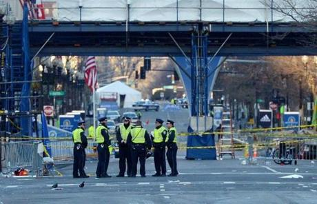 Boston Police officers stood near the finish line of the Boston Marathon on Tuesday morning.