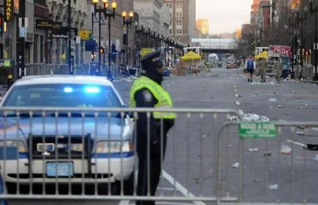 A police officer stood guard at the corner of Boylston Street and Arlington Street early Tuesday.