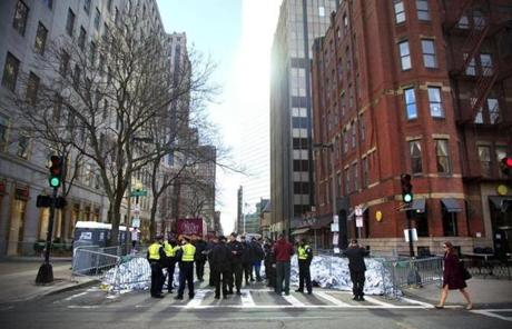 Roads around Boylston Street in Boston's Back Bay were closed and considered an active crime scene on Tuesday morning.