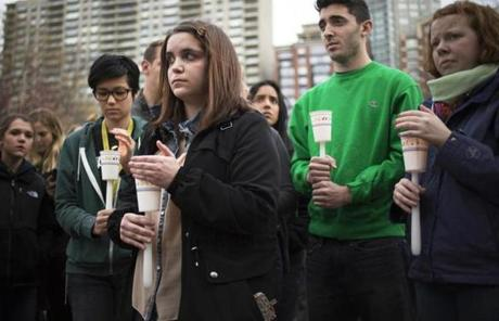 Vigil-goes held candles to honor the victims.