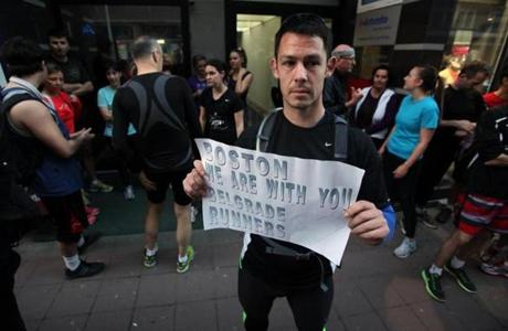 "A runner shows a banner reading: ""Boston we are with you - Belgrade runners"" in an organized memorial run to show solidarity with victims of the Boston Marathon bombing in Belgrade, Serbia."