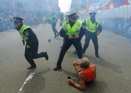 The jolt of the blast knocked this runner to the ground and prompted police to spring into action.