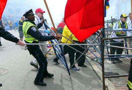 Police and marathon officials struggled to remove the barriers.