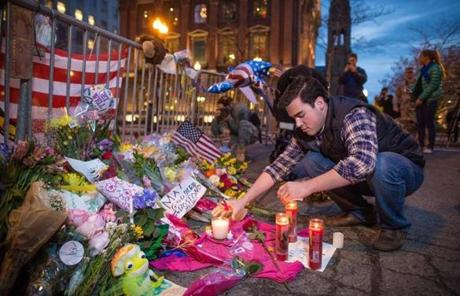 Sam Galvin of West Roxbury added candles to a makeshift memorial on the barricades blocking off Boylston Street.