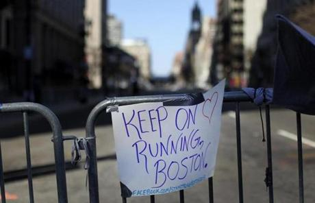 A sign was taped to a barricade near the site of the bombings on Wednesday.